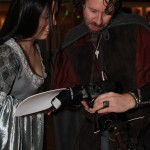 Arwen and Aragorn going over wedding pictures.
